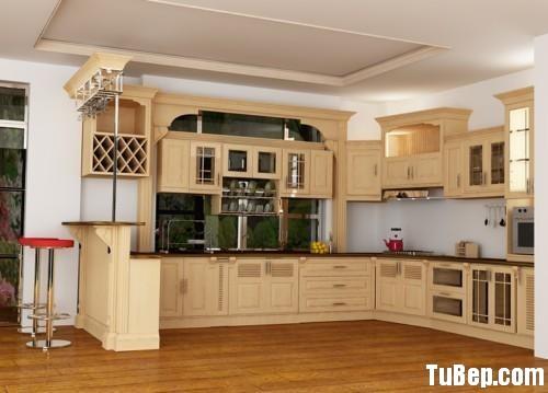 5812f3cae82709.jpg Tủ bếp gỗ tự nhiên sơn men màu trắng kem chữ L có quầy bar – TVB793