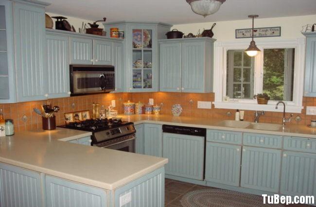 0e35f469b4tthree.jpg Tủ bếp gỗ Xoan đào tự nhiên màu xanh nhạt chữ U TVT0684