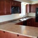 Tủ bếp gỗ tự nhiên Pơmu – TVB415